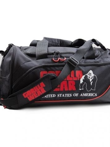 """Jerome Gym Bag – Black/Red  Once again Gorilla Wear has proven to be the best of the best and this has been true since 1982. The new Men`s Gorilla Wear duffel bag is made of ultra-durable fabric and has plenty of pockets to keep your gym gear organized and secure. Furthermore, it offers the user immense storage and protection. In addition, it has a removable adjustable shoulder strap and dual handles for the benefit of versatile carrying options. Lastly, the main zip compartment and side pockets for extra storage space can be used to store bigger items if needed. It's time to show the people that you are a member of the GORILLA WEAR Family.  About Gorilla Wear Since the 80's Gorilla Wear is a legendary American worldwide bodybuilding and fitness lifestyle brand """"for the motivated"""". Every style of apparel is designed for motivated and demanding athletes everywhere in the World. It is unique, it will fit, it will not break down and it will give you the authentic and individual look your body deserves!  Art. No. 9911090500 Color: Black/ Red  Quality: 100% Polyester"""